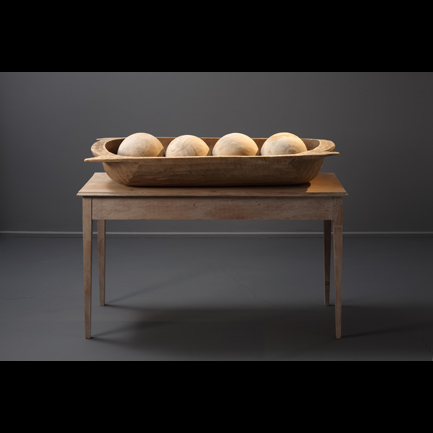 John Udvardy  Sarcophagus , 2008-2010 Limestone spheres and painted wood, 45 x 54 x 20 inches Listing #1