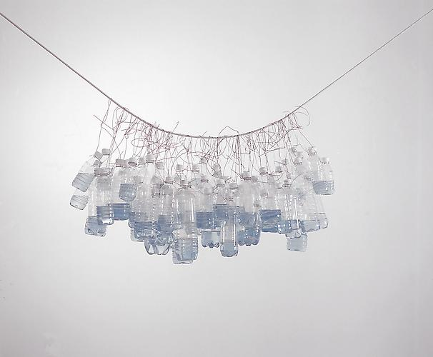 Tony Feher It Seemed a Beautiful Day 2002  bottle cluster approximately 48 x 23 x 23 inches  clear plastic beverage bottles with white screw caps, galvanized steel wire