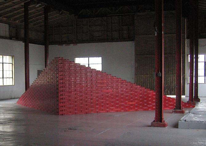 Tony Feher Big Red Wedge 2005  approximately 7 x 30 x 17 feet 2 x 9 x 5 meters  red plastic soda cases