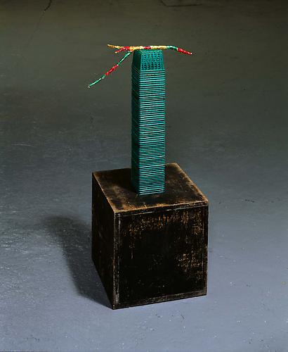 Tony Feher (Jade) 2008  35 1/2 x 13 1/2 x 13 1/2 inches painted wooden cube, plastic berry baskets, stick, foil wrappers