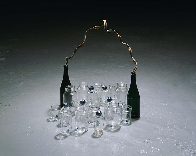 Tony Feher (Flourish) 2007  24 3/4 x 31 x 23 inches glass bottles, glass jars, glass marbles, metal ribbon
