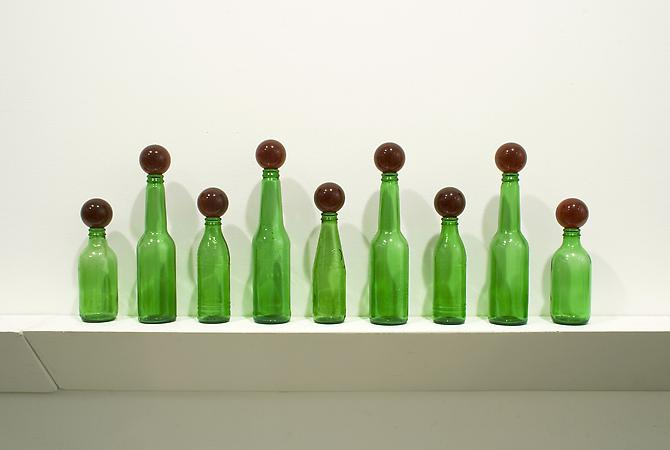 Tony Feher Untitled, 2011 9 green glass bottles and 9 red glass marbles 11 x 36 x 3 1/2 inches