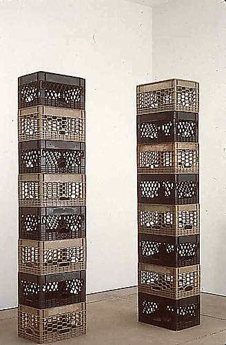 Tony Feher Either/Or 1998  each stack: 84 3/4 x 18 1/2 x 12 3/4 inches  2 stacks of 8 alternating black and tan plastic packing crates