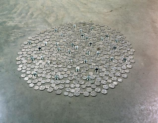 Tony Feher D.C.FIVEANDIME 1999  approximately 23 inches in diameter  nickels, dimes, and 35 clear marbles