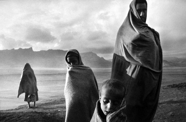 Refugees (Protected by their covers against the cold morning wind) Korem Camp, Ethiopia 1984 Gelatin Silver Print