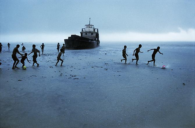 Children Playing Football, Sitwe, Burma 1995 C-type print on Fuji Crystal Archive paper