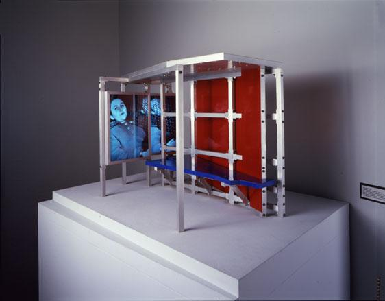 Dennis Adams  Model for Bus Shelter II,  1984 Aluminum, Plexiglas, enamel, Duratrans, fluorescent light, and wooden base 18 1/2 x 30 x 23 1/4 in. Edition of 2