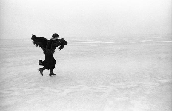 Joel Bernstein, Joni Mitchell Skating on Lake Mendota, Madison, WI 1976