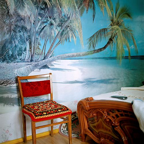 OLGA CHAGAOUTDINOVA | CHAIR AT THE BEACH IN THE BEDROOM | C-PRINT | 61 x 61 CENTIMETERS | 2006