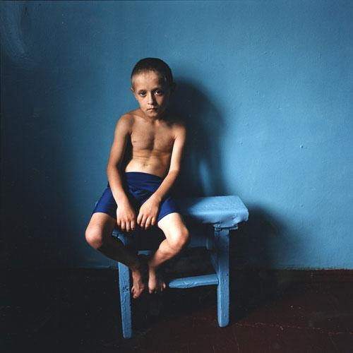Boy on a Stool, Ukraine , 2006 C-Print 37 x 37 inches Edition of 5