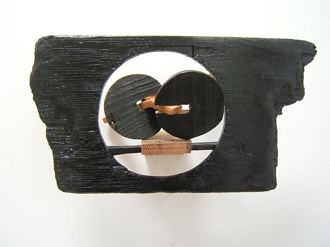 "Paul Bowen, 2012  Portal , wood and asphaltum 9"" x 17"" x 7"""