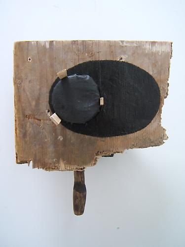 "Paul Bowen, 2012  Black Rhys , wood, fabric and asphaltum 15"" x 13"" x 7"""
