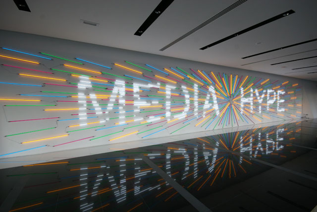 Media Hype, 2011 installation fluorescent tube lights and light filters 62 feet x 10 feet wall