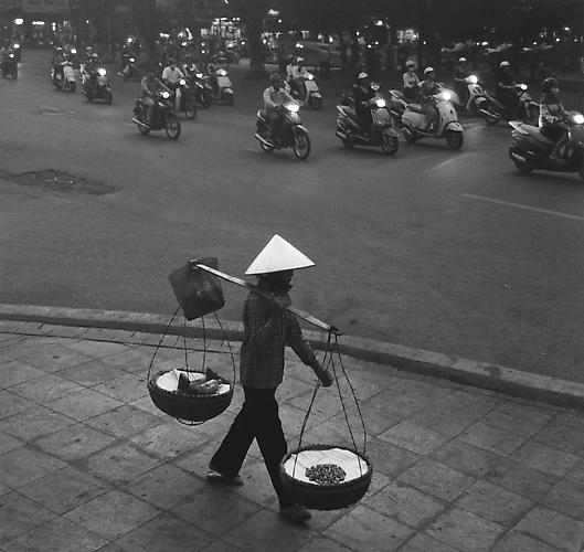 Untitled, (Walking Amongst Scooters) 2011 gelatin silver print