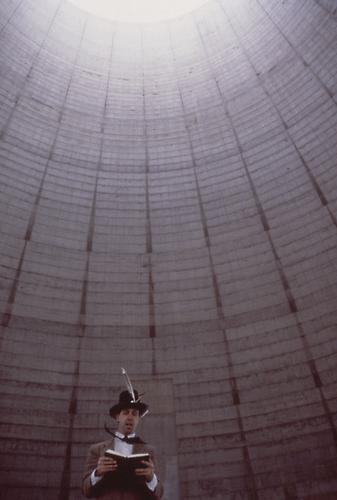 Jay Critchley, Bible reading by artist, abandoned nuclear power plant cooling tower, Tennessee Valley Authority, 1988.