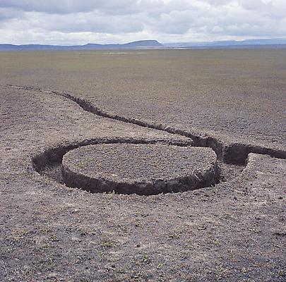 "Michael Heizer, ""Isolated Mass / Circumflex,"" 1968 (deteriorated). #9 of Nine Nevada Depresssions. 6 ton displacement in playa surface, 12 x 12 x 1 feet. Location: Massacre Dry Lake, Vya, Nevada Image"