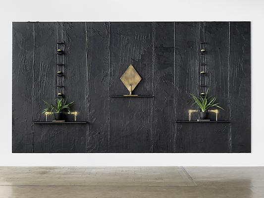 "Rashid Johnson ""Our People, Kind Of"" 2010 Black soap, wax, brass, books, spray paint, plants, shea butter Private Collection © Rashid Johnson Image"