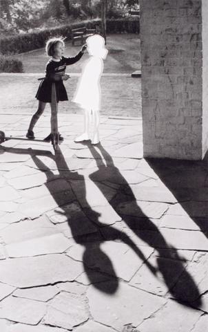 Hans-Peter Feldmann, <i>Two Girls with Shadow</i> (2004) Silver gelatin print 37.19h x 25.13w in (94.5h x 63.8w cm)