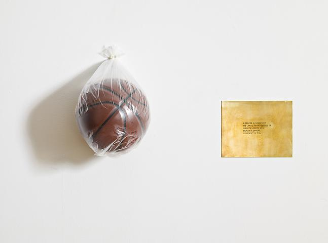 "A sphere is shaped by its limits. With a radius of infinite length will remain a sphere. Comment on this. From the series ""The Assignment Books"" (2011) Brass plaque with mixed media; dimensions variable"