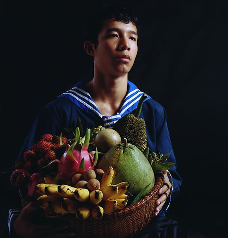 Boy with a Basket of Fruit (2010) Pigment print; Edition of 7 with 1 AP 27h x 28w in (68.58h x 71.12w cm)