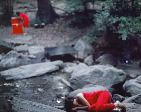 Rivers, First Draft: The Woman in Red cooks, and the Teenager in Magenta lies curled across the stream (1982/2015) Digital C-print from Kodachrome 35mm slides in 48 parts, 16h x 20w in (40.6h x 50.8w cm) Edition of 8 with 2 AP