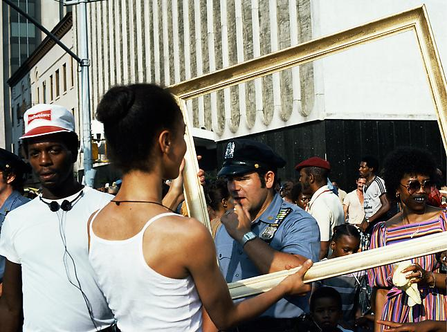 Lorraine O'Grady Art Is. . . (Cop Eyeing Young Man) (1983/2009) C-print: 16h x 20w in (40.64h x 50.8w cm); Edition of 8 with 1 AP