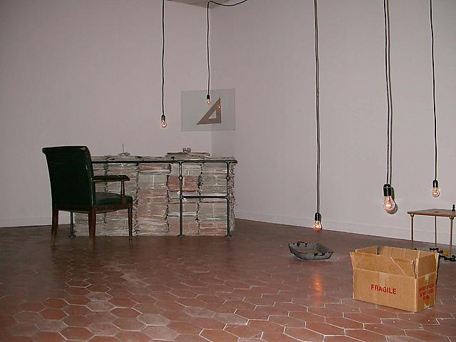 The Office (2000-2001) Metal, wood, cardboard, paper, and glass Installation view (2000-2001)