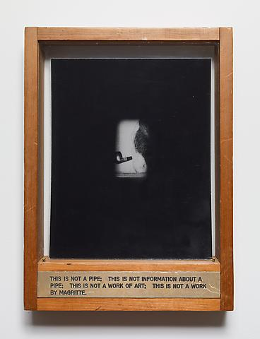 This is not a pipe. This is not information about a pipe. This is not a work of art. This is not a work by Magritte. (1974) Engraved brass plaque, laminated photograph, glass, and wood 13.5h x 10w x 2d in (34.3h x 25.4w x 5.1d cm)