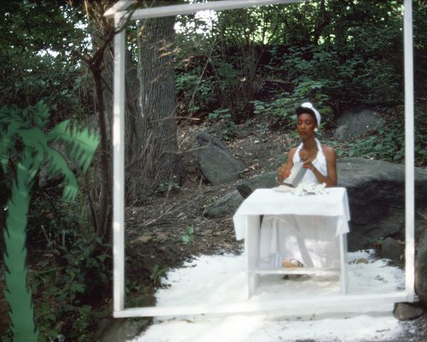 Rivers, First Draft: The Woman in White grates coconut in her kitchen, with the fir-palm tree outside (1982/2015) Digital C-print from Kodachrome 35mm slides in 48 parts, 16h x 20w in (40.6h x 50.8w cm) Edition of 8 with 2 AP