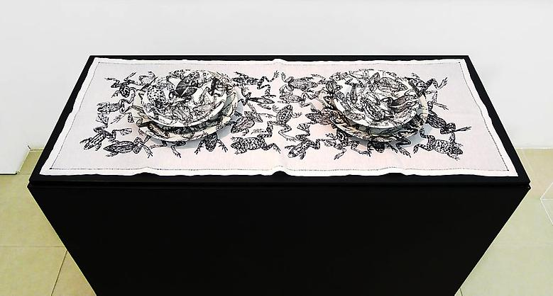 Feast (2013); Porcelain, embroidered towel, and acrylic in five parts Dimensions variable Installation view; Bolsa de Arte de Porto Alegre, Brazil, 2013