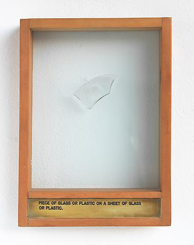 Luis Camnitzer Piece of Glass or Plastic on a Sheet of Glass or Plastic (1973-1976); Mixed media 13.5h x 9.88w x 2d in (34.29h x 25.1w x 5.08d cm)