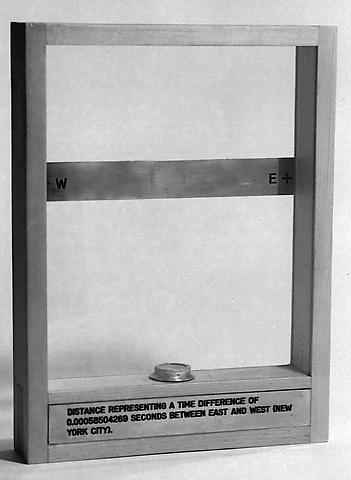 Distance Representing a Time Difference of 0.00058504269 Seconds Between East and West (New York City) (1973-1975) Compass, engraved brass plaques, glass and wood 13.58h x 9.96w x 1.97d in (34.49h x 25.3w x 5d cm)