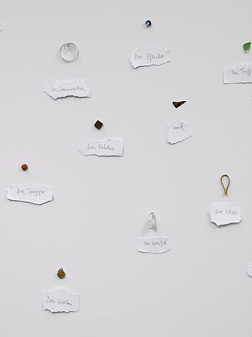 Arbitrary Objects and Their Titles (1979/2010) Found objects and pencil on paper on wall Dimensions variable