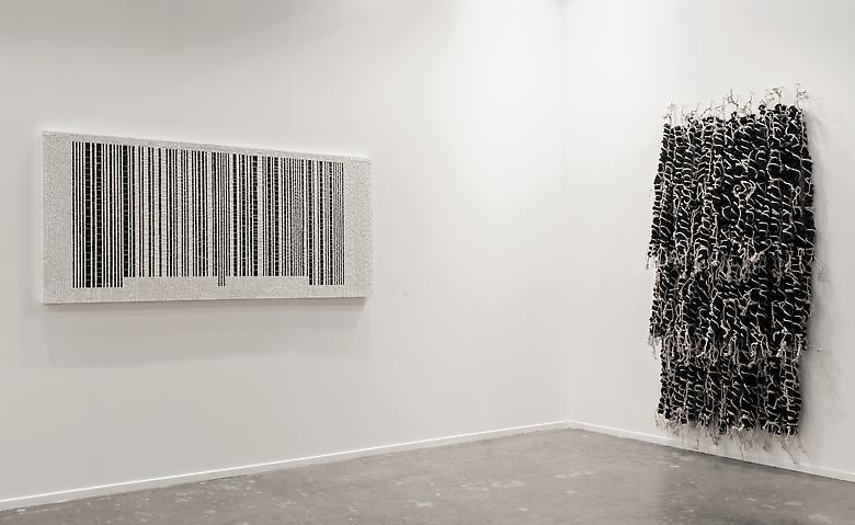 Left: Jack Whitten, Bar Code #1 (Rutilation for Mary) (2007); Right: Hassan Sharif, Weave 1 (2013) Art Dubai 2013 Installation view