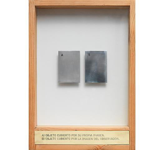 A) Objeto Cubierto por Su Propia Imagen. B) Objeto Cubierto por la Imagen del Observador. (1971-1974) Aluminum, engraved brass plaque, glass, wood 13.5h x 9.88w x 2d in (34.29h x 25.1w x 5.08d cm)