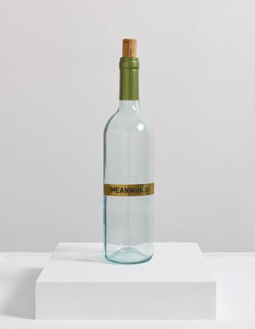 Meanwhile (2014) Glass, brass plaque, cork, and aluminum 15.6h x 3w x 3d in (39.6h x 7.6w x 7.6d cm)