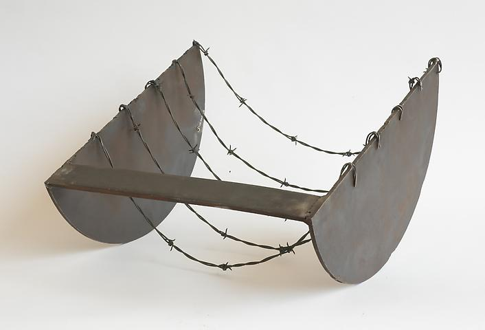 Five to the Bar (1973) Welded steel and barbed wire 14h x 20.5w x 20d in (35.56h x 52.07w x 50.8d cm)