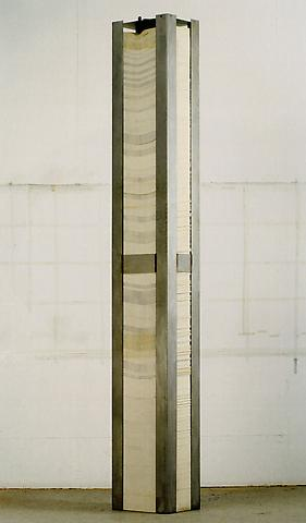 A Number Between Zero and One (1970) Steel, paper 104h x 15w x 11d in (264.2h x 38.1w x 27.9d cm)