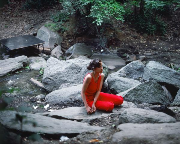 Rivers, First Draft: The Teenager in Magenta sits alone with her headphones (1982/2015) Digital C-print from Kodachrome 35mm slides in 48 parts, 16h x 20w in (40.6h x 50.8w cm) Edition of 8 with 2 AP