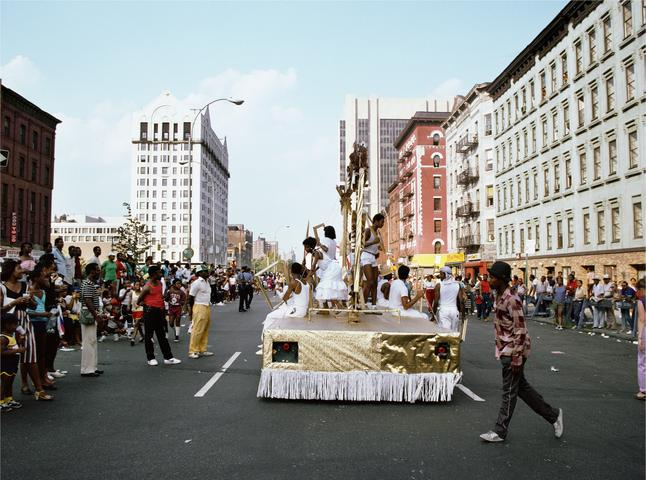 Art Is. . . (Float on 125th Street) (1983/2009 ) C-print 16h x 20w in (40.6h x 50.8w cm)
