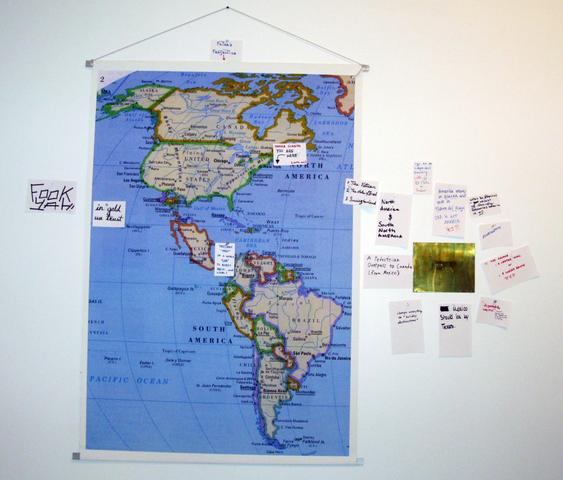 """Suggest geographic corrections to improve national wellbeing and explain. From the series """"The Assignment Books"""" (2011) Brass plaque with digital print on canvas, dimensions variable"""