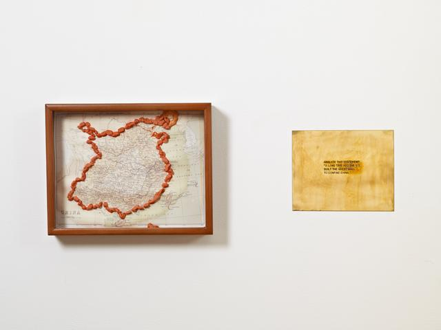"""Analyze this statement: """"A long time ago the U.S. built the Great Wall to confine China."""" From the series """"The Assignment Books"""" (2011) Brass plaque with mixed media, dimensions variable"""