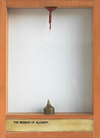The Reason of Alchemy (1973-1976) Brass plaque, glass, resin and cut Mason's plumb 13.5h x 9.88w x 2d in (34.29h x 25.1w x 5.08d cm)