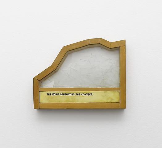The Form Generating the Content (1973-1997) broken glass, engraved brass plaque, glass and wood 7.68h x 9.96w x 1.97d in (19.51h x 25.3w x 5d cm)