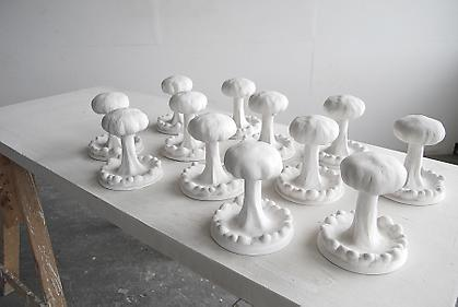 Kenny Hunter Atomic Field 2009, plaster, wood, trestles, 3.94 x 59.06 x 23.62 inches.