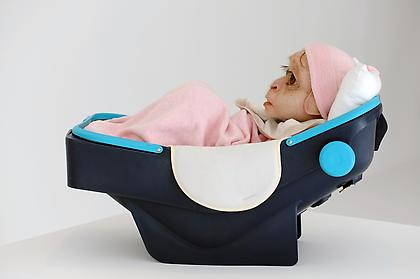 PATRICIA PICCININI Foundling 2008, Silicone, human hair, polyester, nylon, wool, glass, plastic, 26 x 16 x 14.5 inches