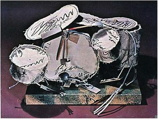 Claes Oldenburg 	<i>Miniature Soft Drum Set</i> 	3-D screenprint and spray paint 	on canvas with rope and wood 	Edition of 200 	11 x 19 x 14 inches 	27.94 x 48.26 x 35.56 cm