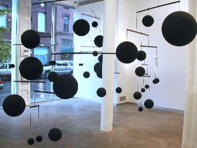 Mobile Installation view at Sandra Gering Gallery, 2005 Plastic, paint, aluminum, nylon 25 spheres Dimensions variable