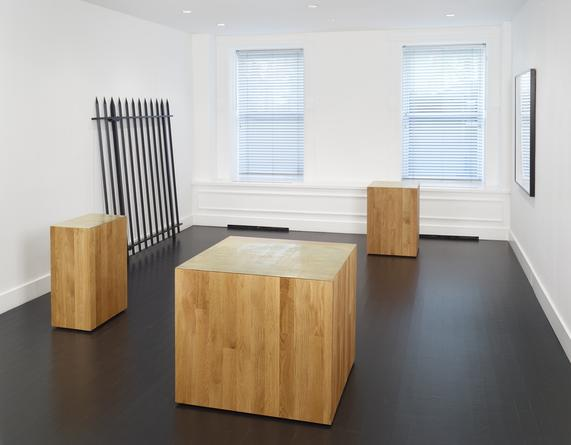 Installation view: Three new buildings, a fence and a factory.