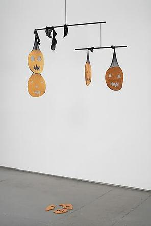 MATTHEW RONAY Adorn Their Sermons, 2007 Powder-coated aluminum, steel rods, fishnet stockings, vinyl-covered aircraft wire, metal hook 5 jack-o-lantern shapes: 14 x 12 x ¼ inches each, approximately, 36 x 3/8 inch rod, 20 x 3/8 inch rod Overall dimensions variable Edition of 10